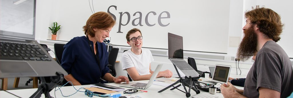 Entrepreneurs interacting in UWE Bristol's Launch Space